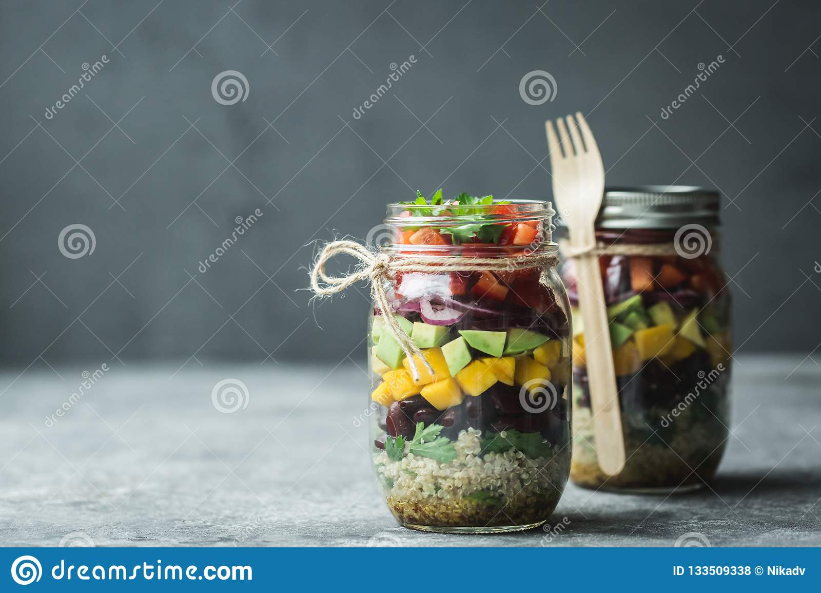 Healthy homemade salad in mason jar with quinoa and vegetables. Healthy food, clean eating, diet and detox. Copy space