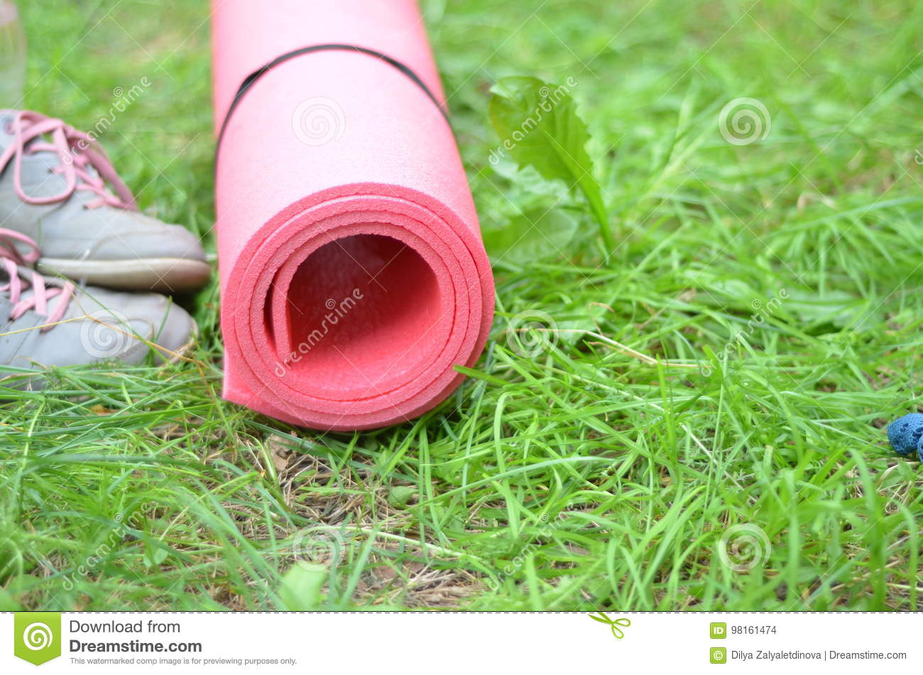 570985263822d Healthy lifestyle background. Yoga mat, sport shoes, bottle of water on  grass background