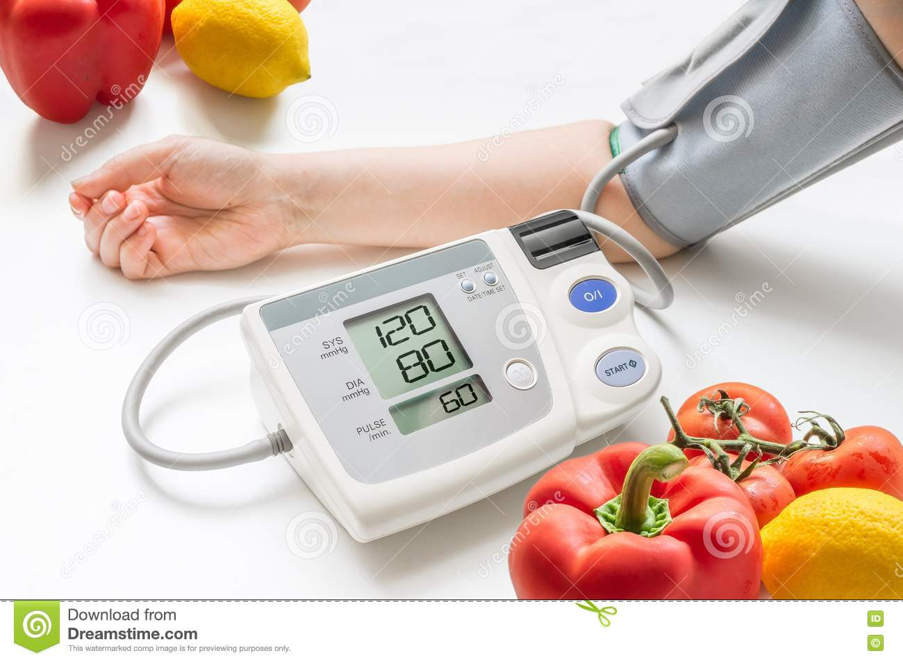Healthy lifestyle concept. Woman is measuring blood pressure with monitor.
