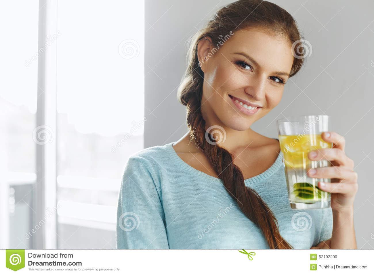 Healthy Lifestyle And Food. Woman Drinking Fruit Water. Detox. H