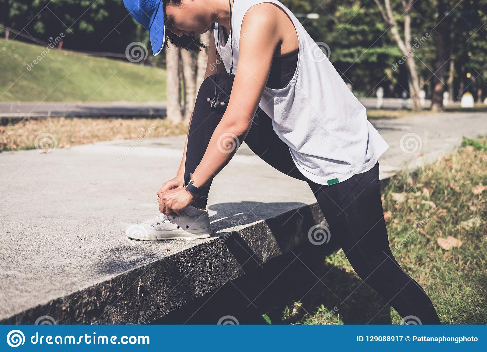 Healthy lifestyle, Runner tying running shoes getting ready for