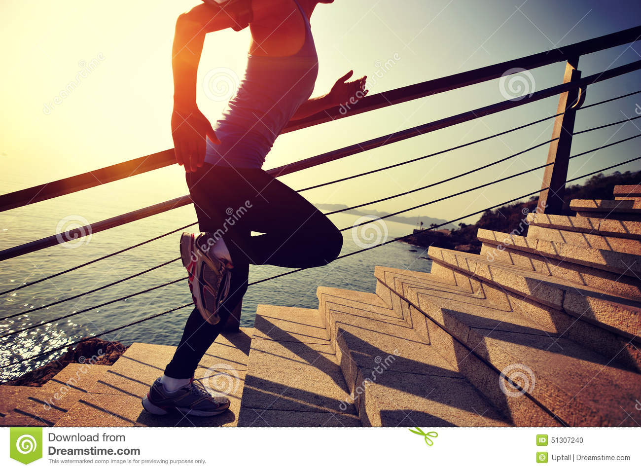 Healthy lifestyle sports woman running up on stone stairs for Lift style