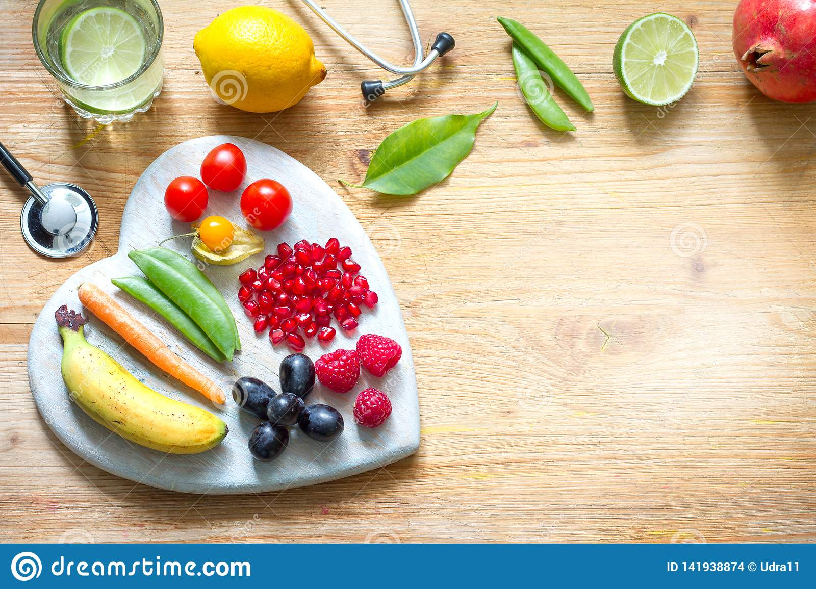 Healthy lifestyle vegetarian food in heart and stethoscope with water alternative medicine background concept