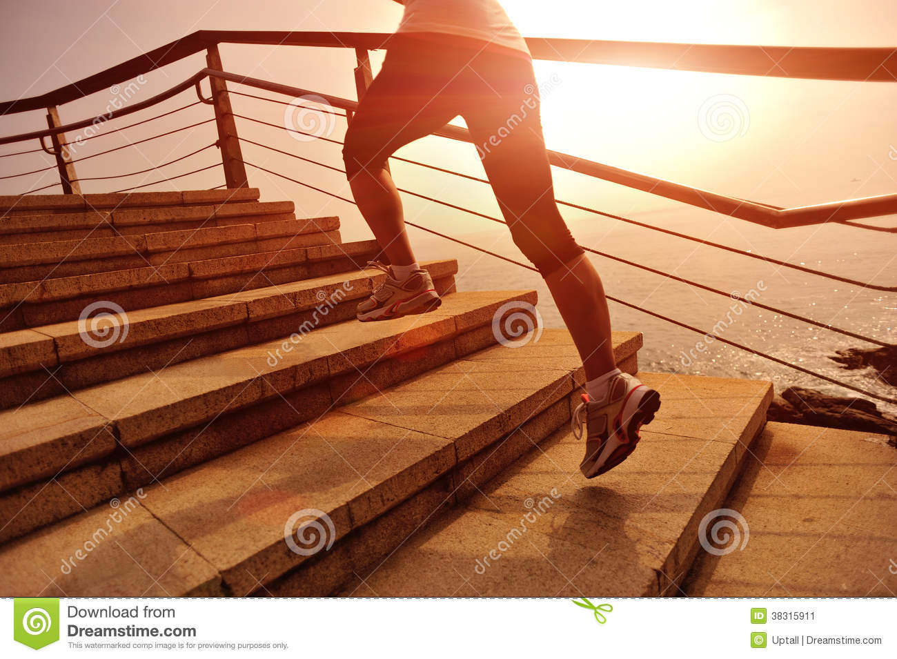 Healthy lifestyle woman legs running on stone stairs