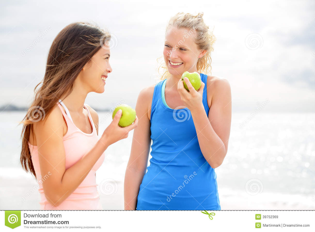 Healthy lifestyle women eating apple after running