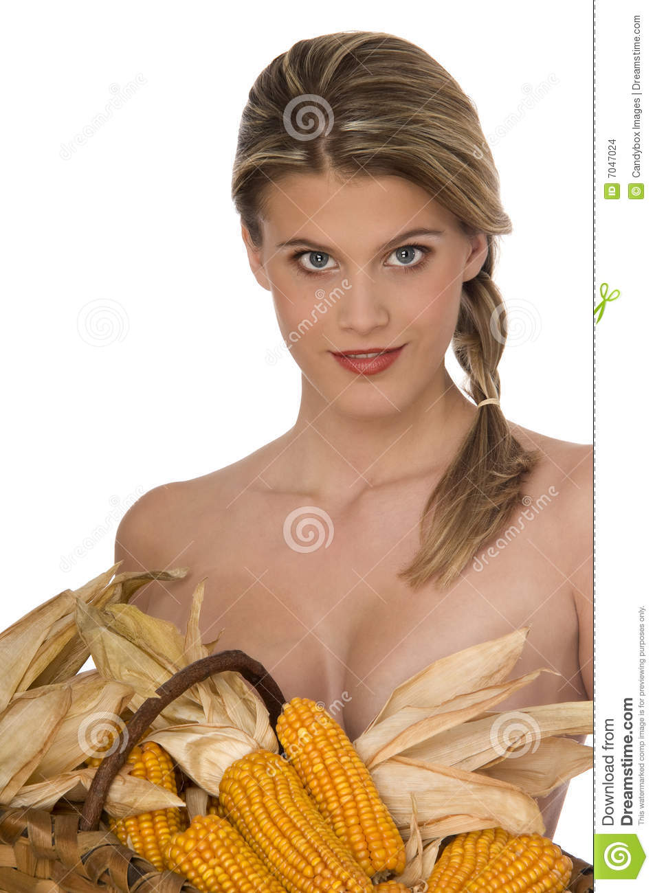 Healthy Looking Woman Hold A Basket Full Of Corn Stock