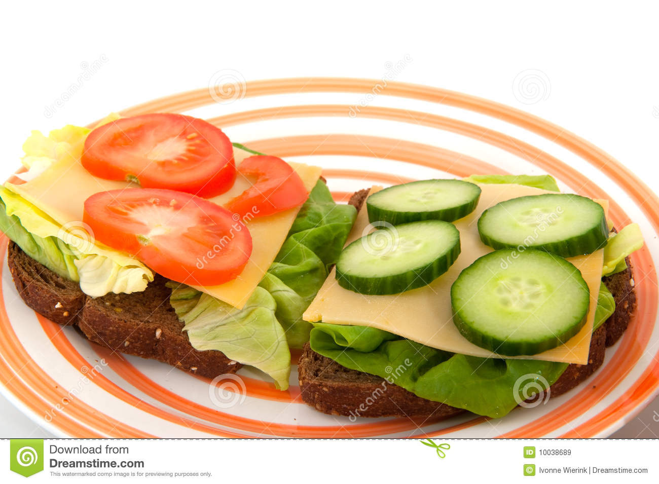 Healthy lunch with whole meal bread cheese and vegetables.
