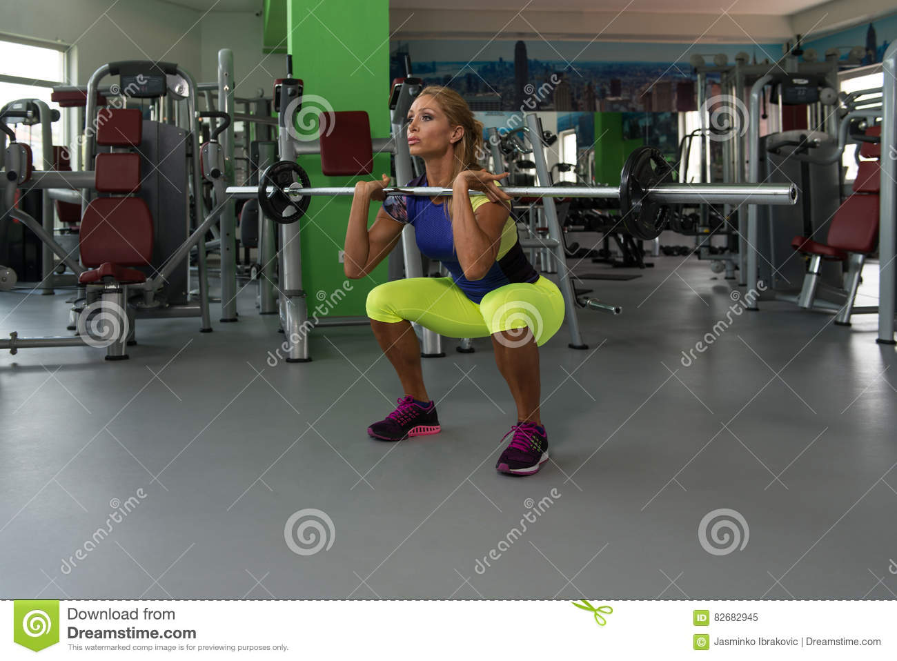 Healthy Fitness Woman Working Out Legs With Barbell In A Gym Squat Exercise Muscular Athletic Bodybuilder Fitness Model