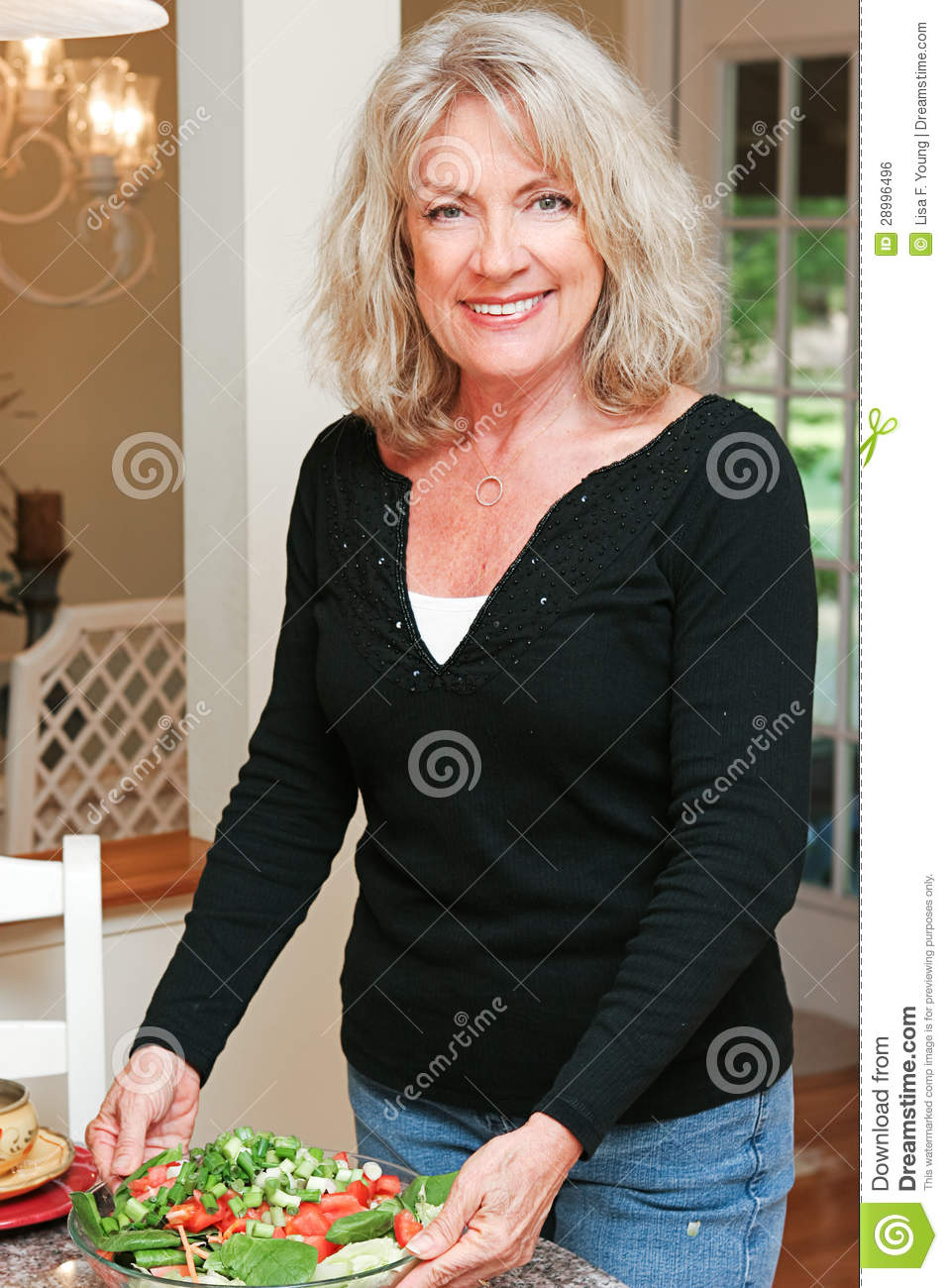 Healthy Mature Woman With Salad Royalty Free Stock Image