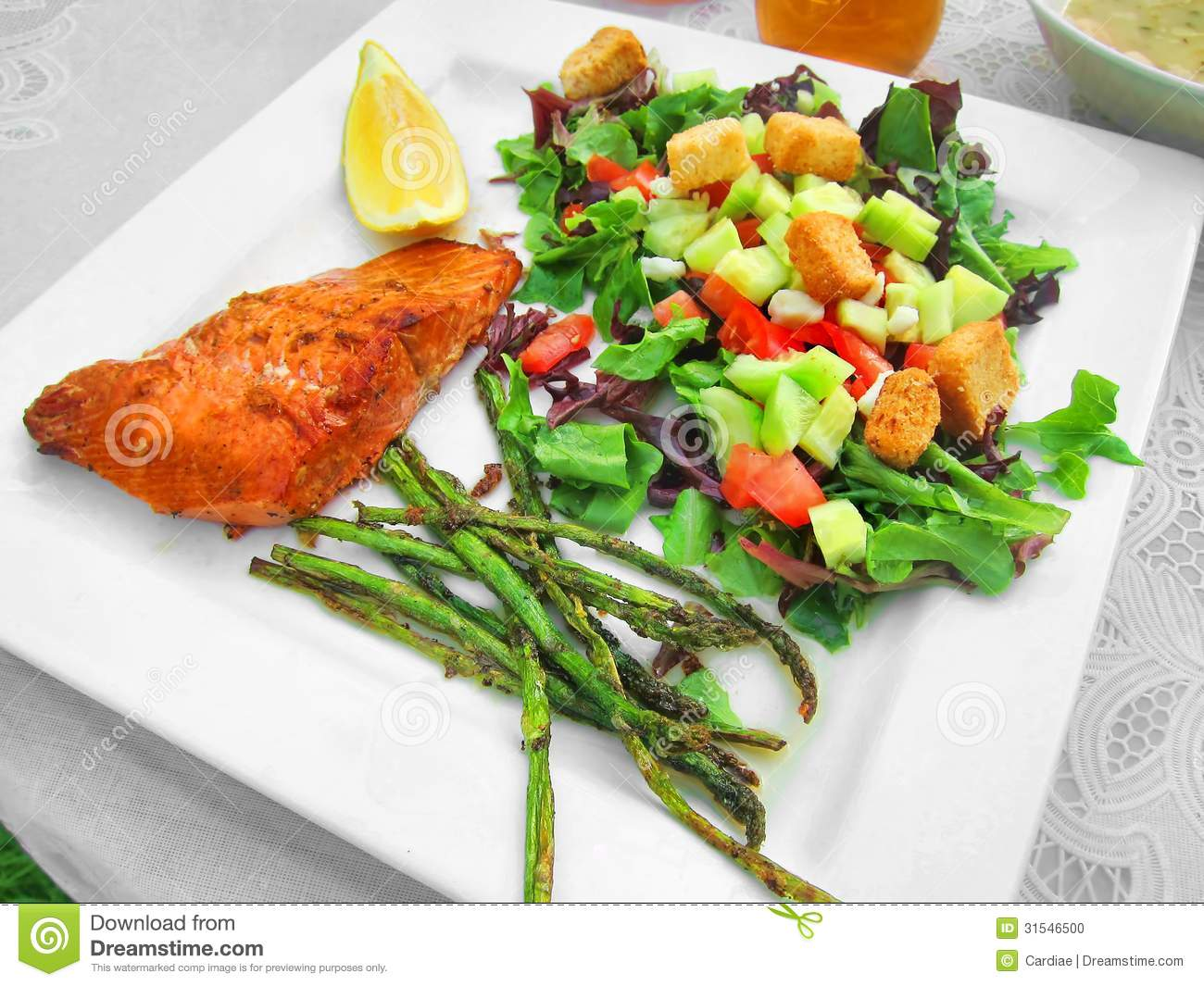 Healthy meal dinner lunch on white plate with fish salmon trout and