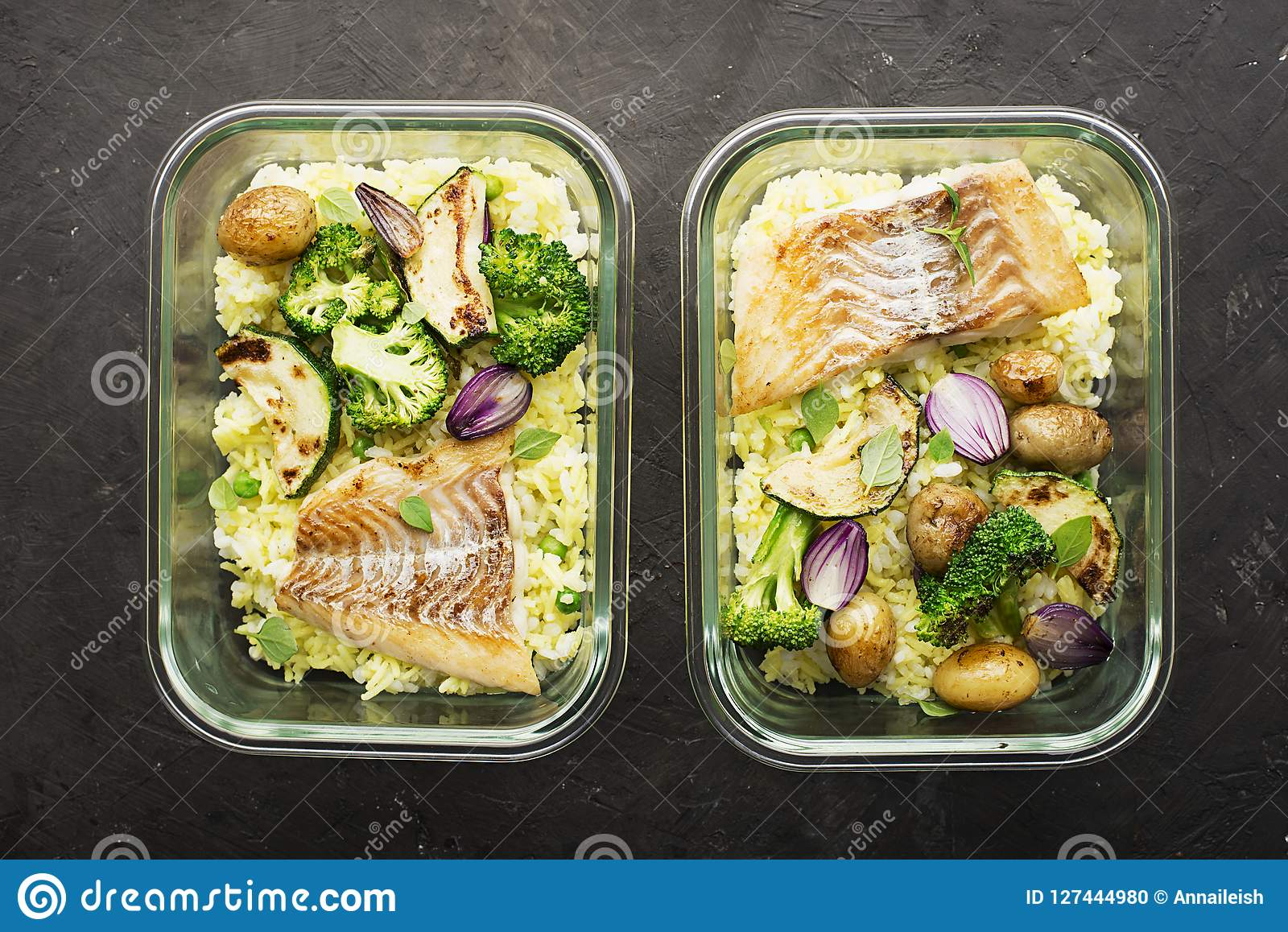 A healthy meal for a snack is a lunch box. Glass containers with fresh steam sea fish, rice with turmeric, fresh