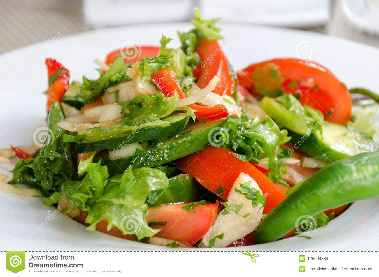 Healthy natural food, fresh salad with vegetables in plate