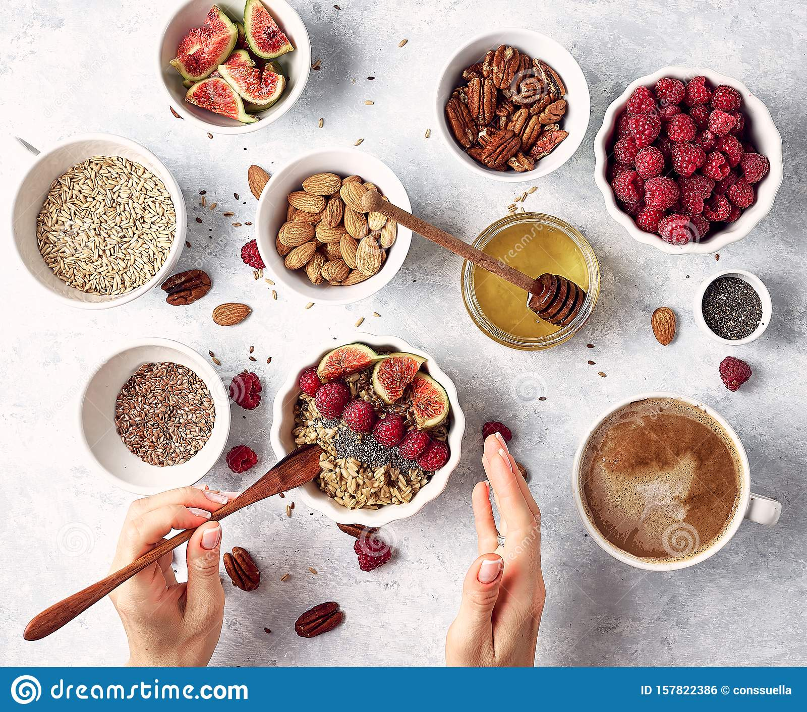 Healthy oatmeal breakfast with raspberries and finns, chia and flax seeds and honey, pattern, top visas, good morning concept