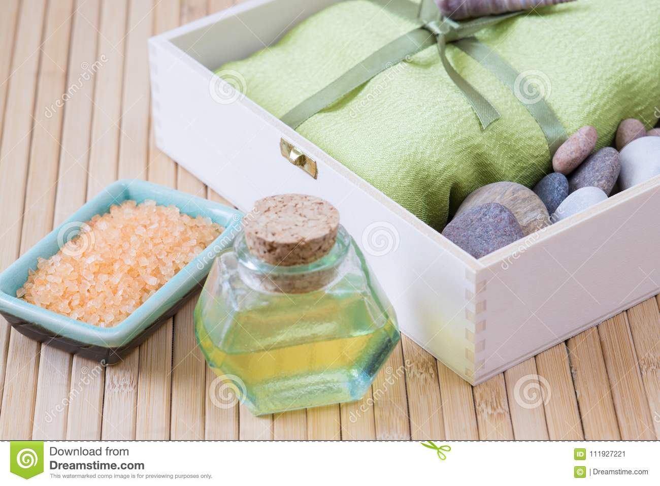 Healthy outfit for relaxation and SPA procedures with towel, stones and body oil