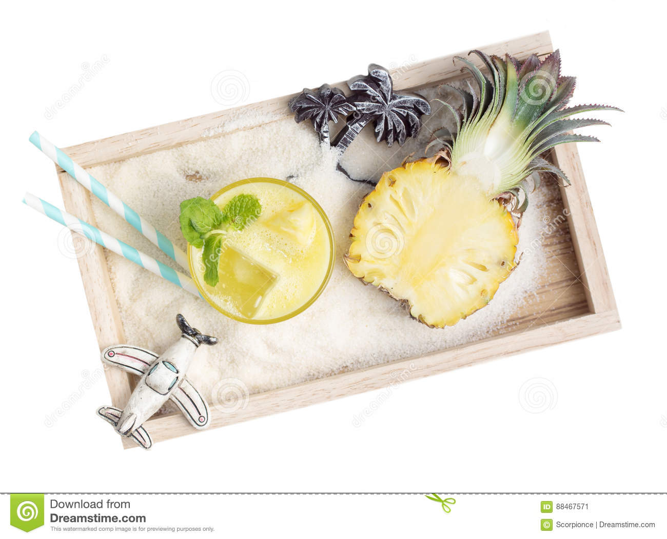 Healthy Pineapple Drink With Toys In Sand On Wooden Tray Stock Image
