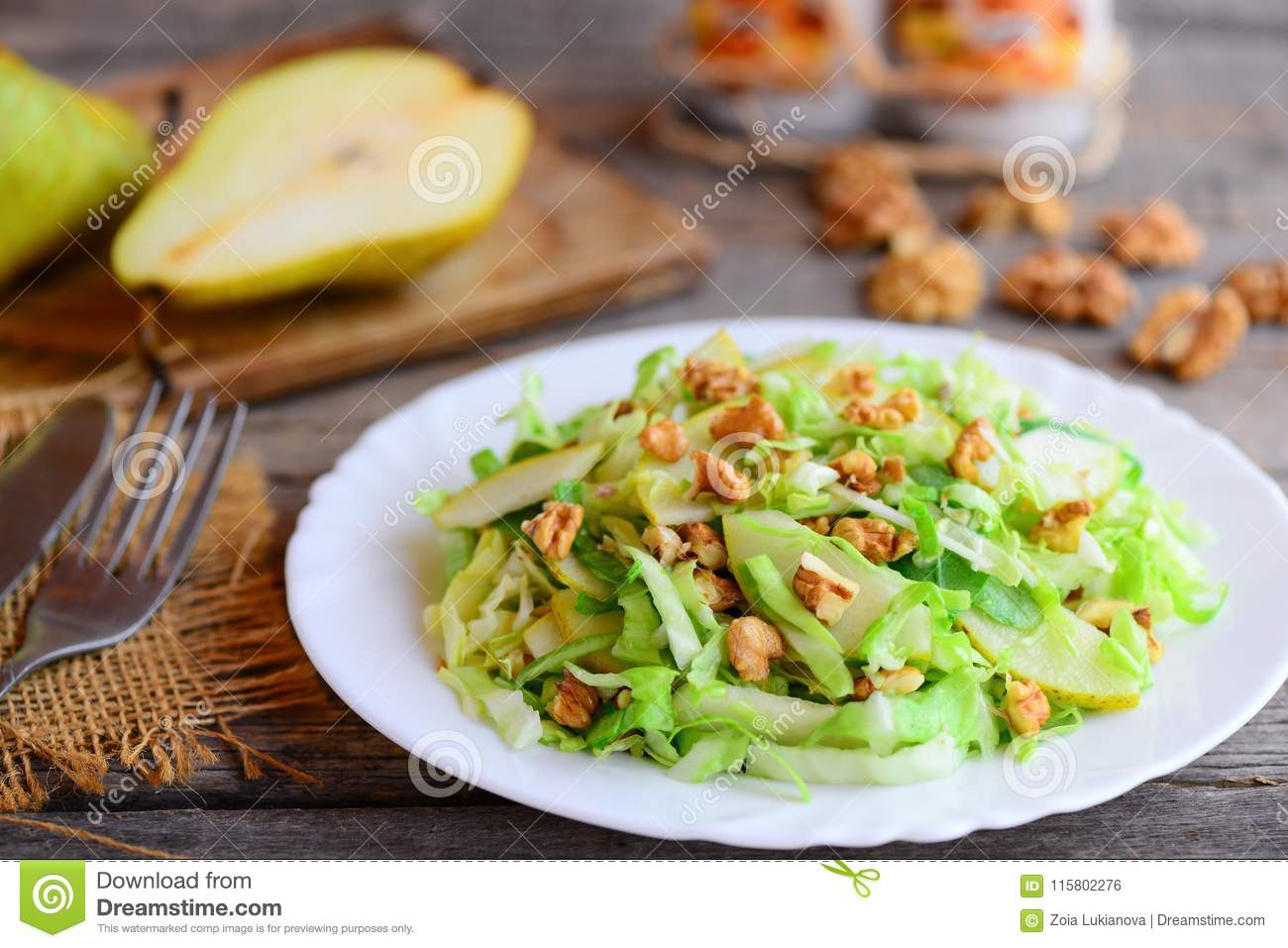 Cabbage And Pear Salad Easy Salad With Fresh Pear Cabbage And Walnuts On A White Plate And On Rustic Wooden Background Stock Photo Image Of Homemade Pear 115802276