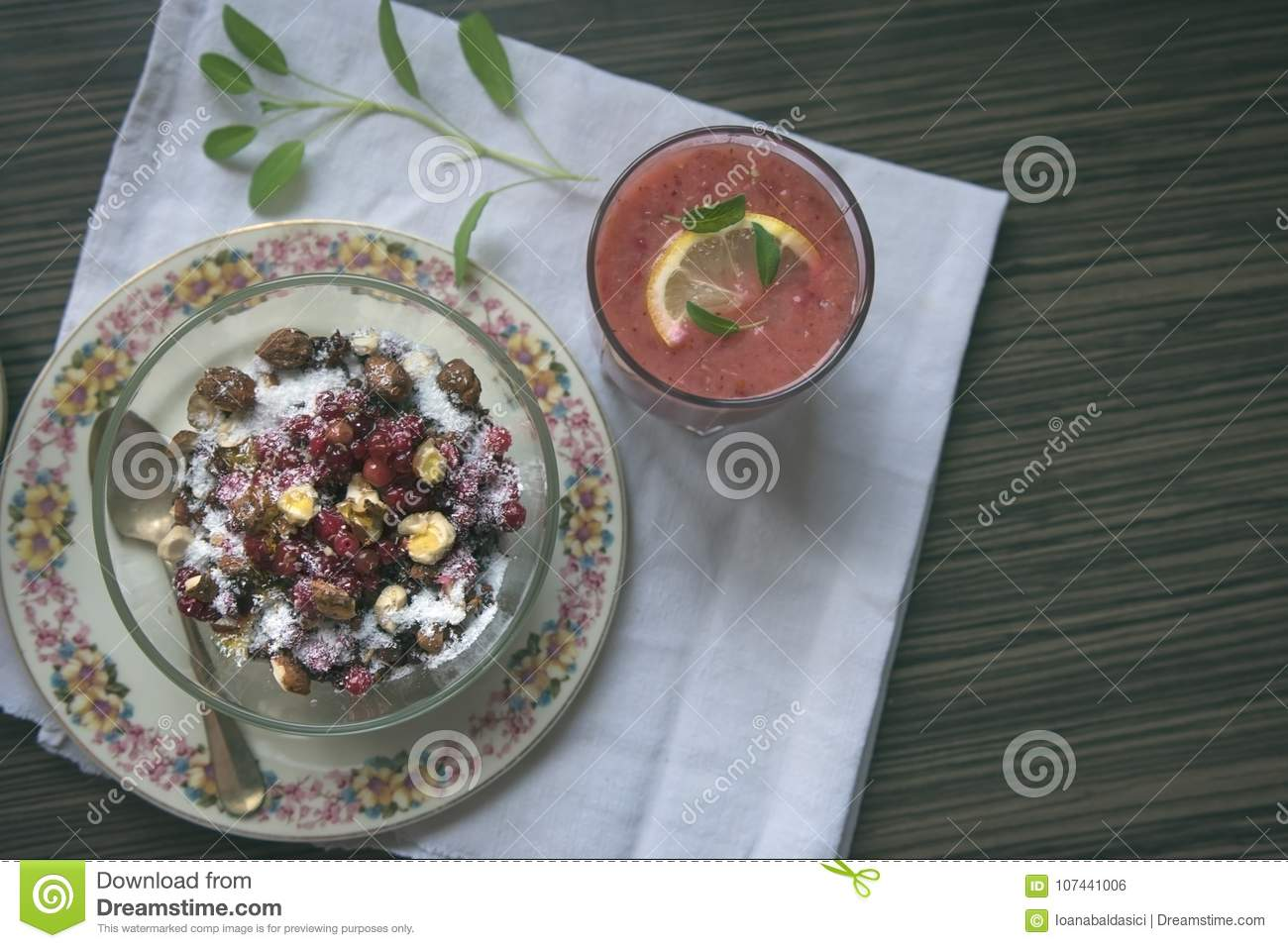 Healthy snack, pudding with berries and nuts along with a glass