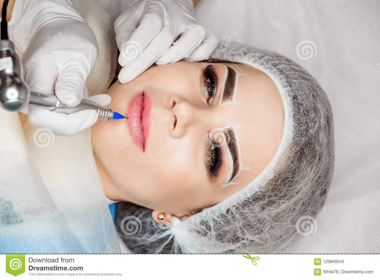 Healthy Spa. Young Beautiful Woman Having Permanent Makeup Tattoo On ...