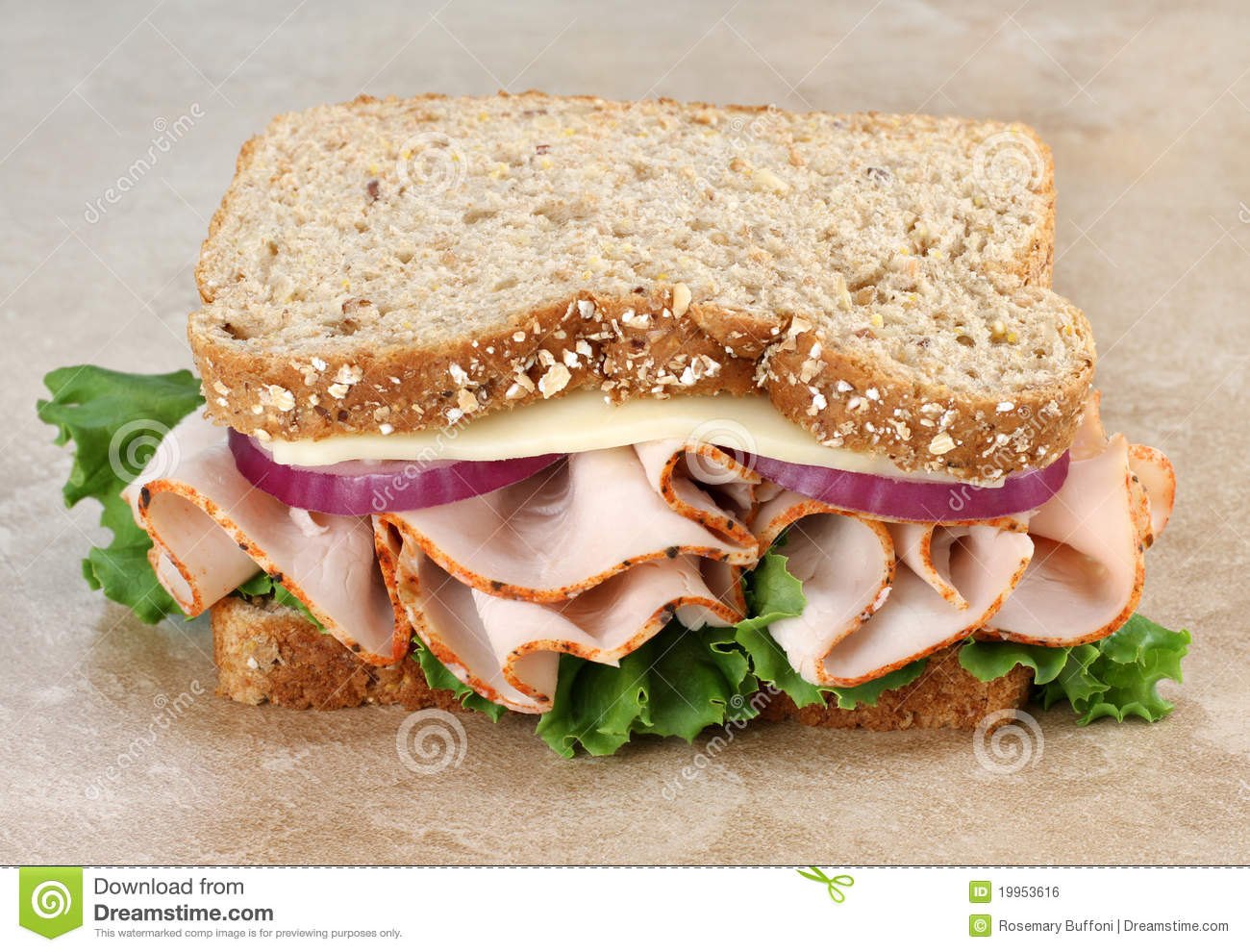 Close up of a healthy turkey  cheese  onion and lettuce sandwich on    Healthy Turkey Sandwich