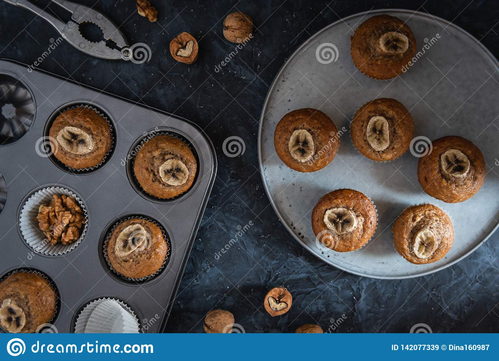 Healthy vegan banana muffins in a baking tray. Top view