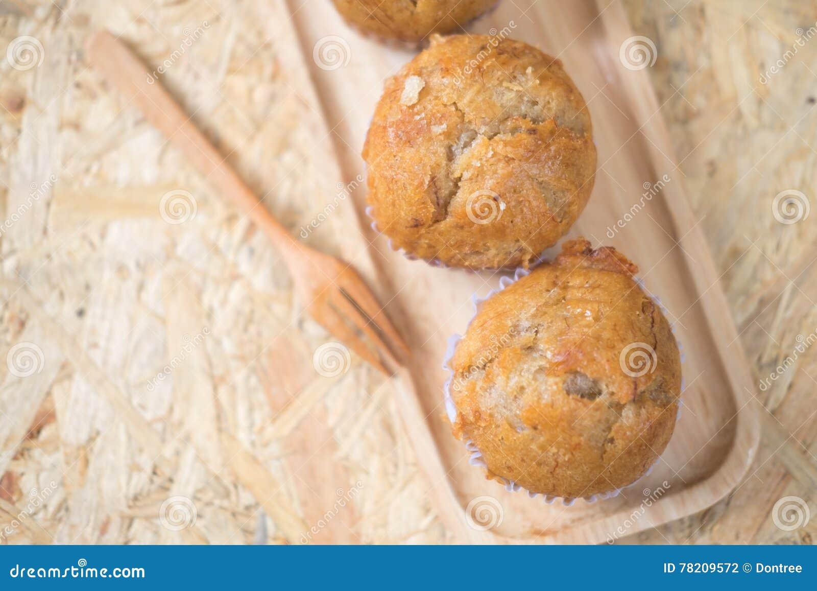 Healthy vegan banana muffins in wood pan