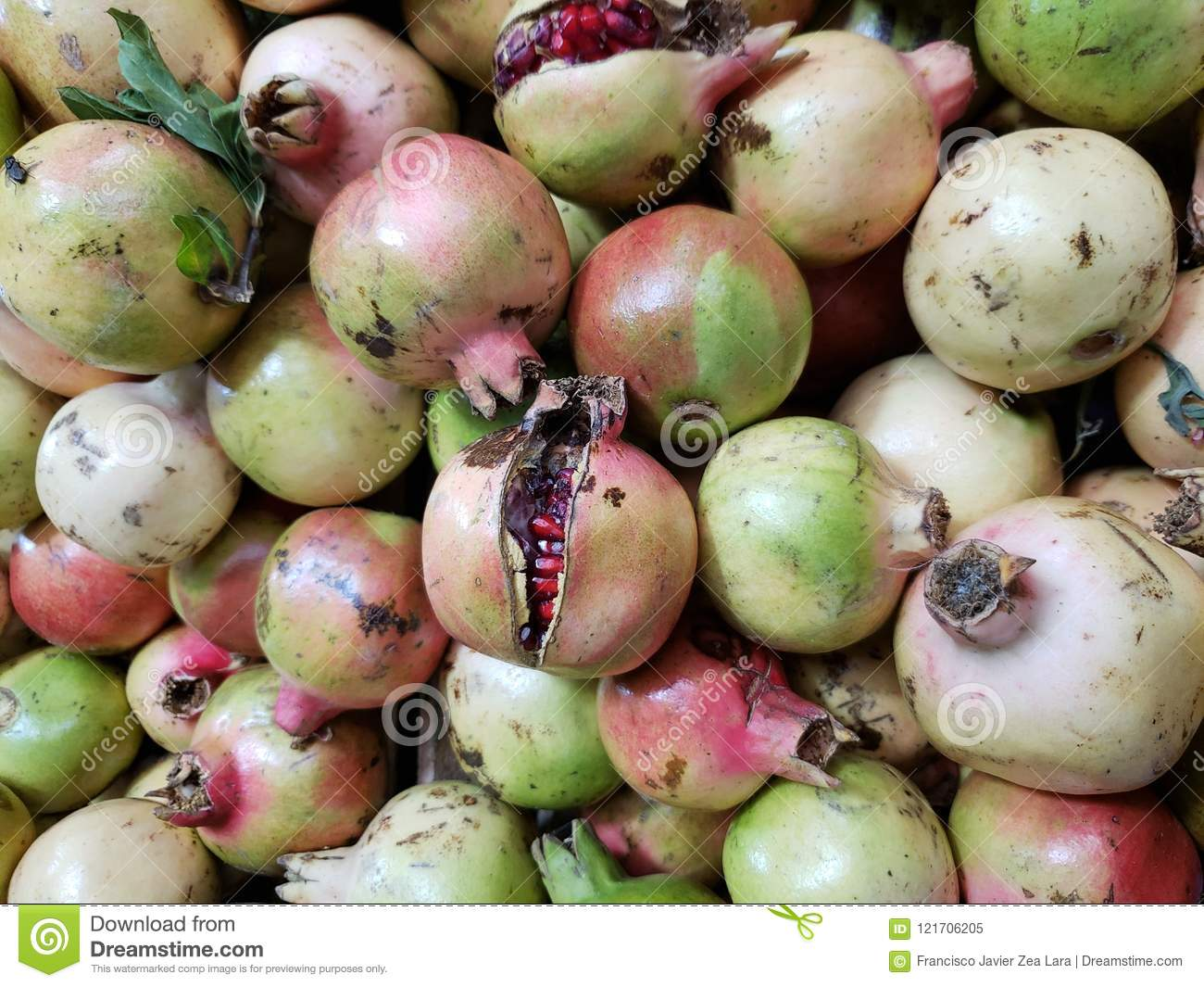 lot of granada fruit in a market background and texture stock image