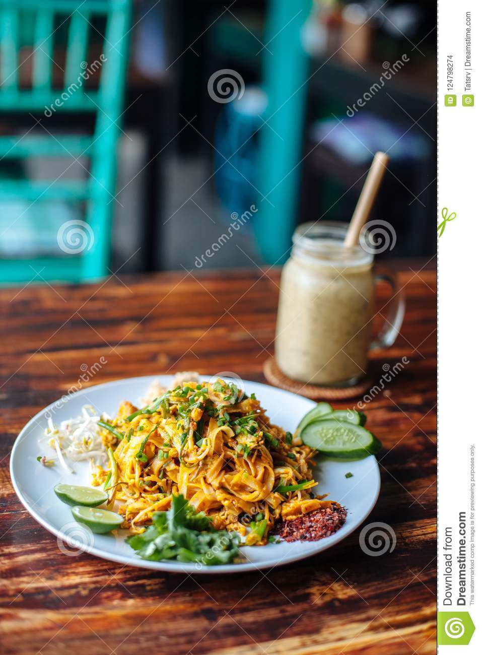 Healthy Vegetarian vegan menu Pad Thai, stir-fried rice noodles, is one of Thailand`s national main dish and banana smoothies on