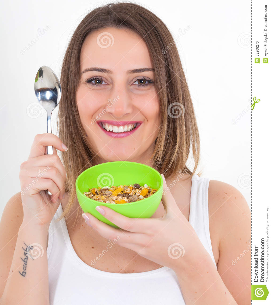 healthy-woman-eating-cereal-38208270.jpg