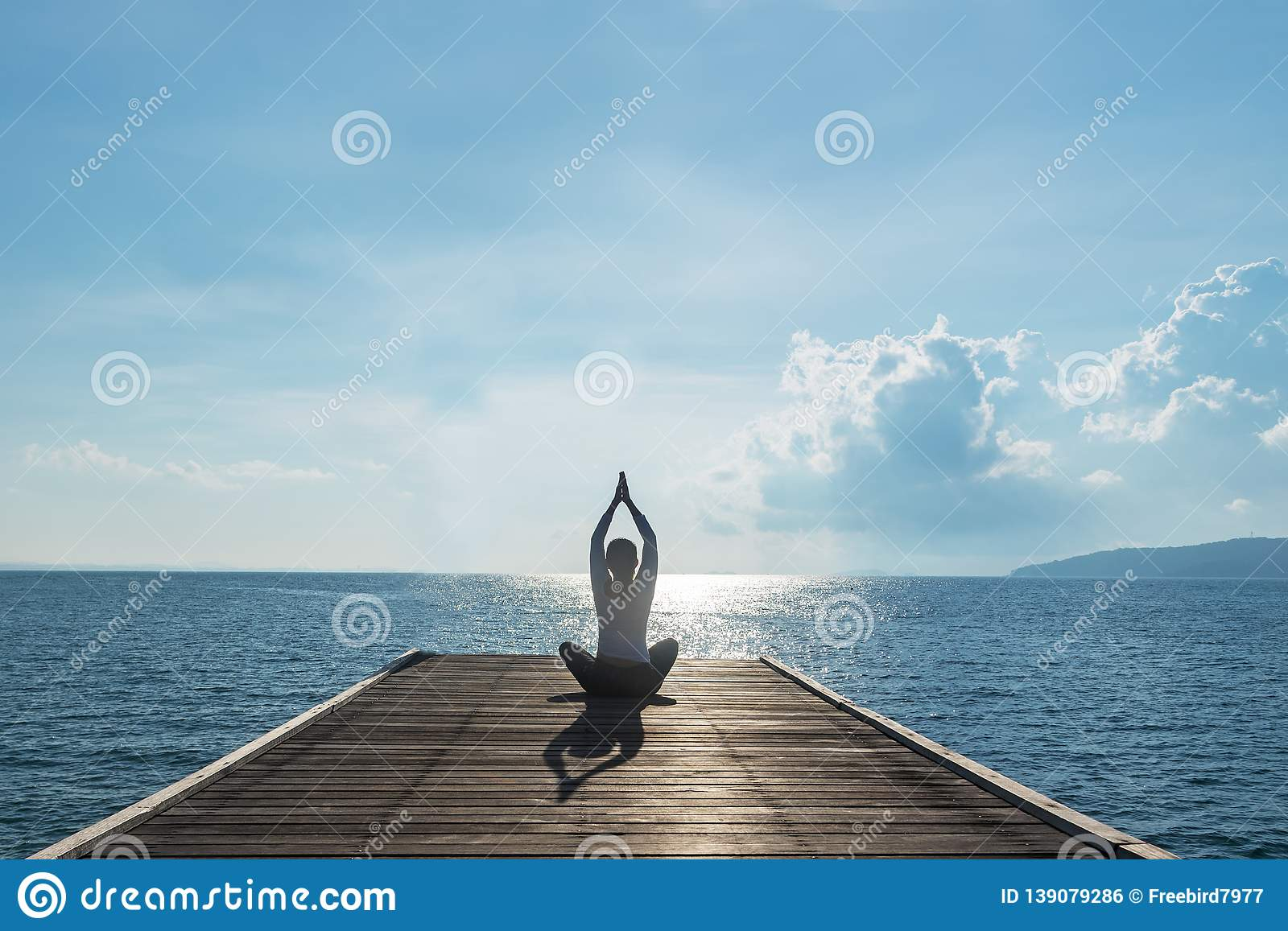 Healthy woman lifestyle balanced practicing meditate and zen energy yoga on outdoors the bridge in morning.