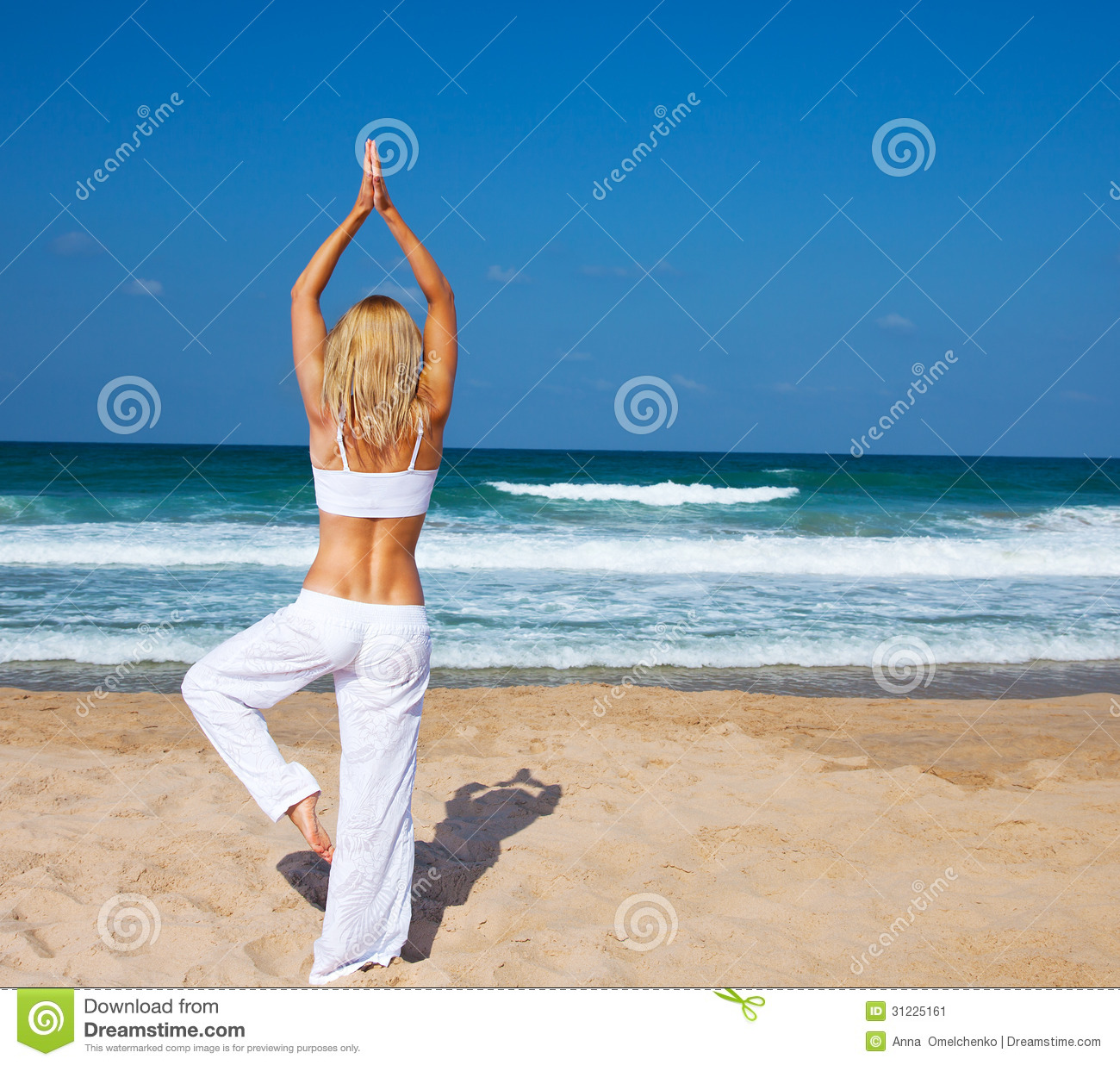 Healthy Yoga Exercise On The Beach Stock Image