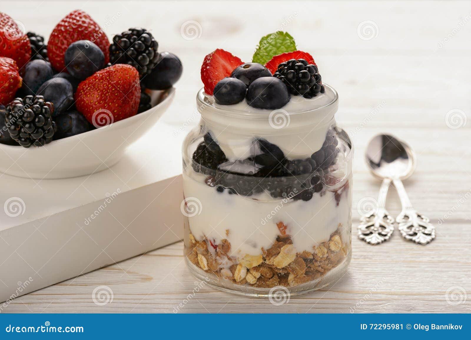 yogurt with strawberry blueberries and muesli stock