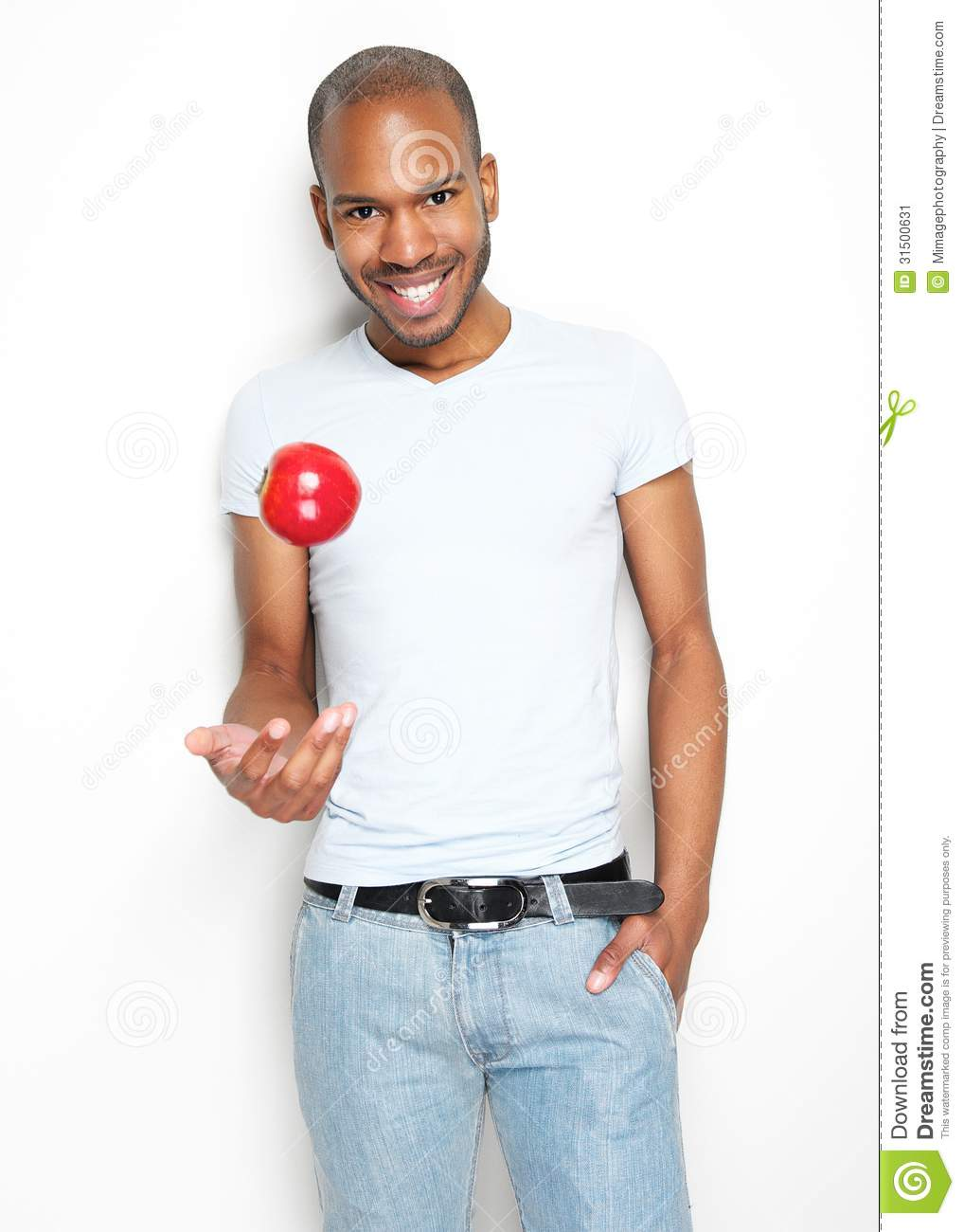 Samu L. Jackson (Would U Be Mad Edition) Healthy-young-man-throwing-up-red-apple-portrait-31500631