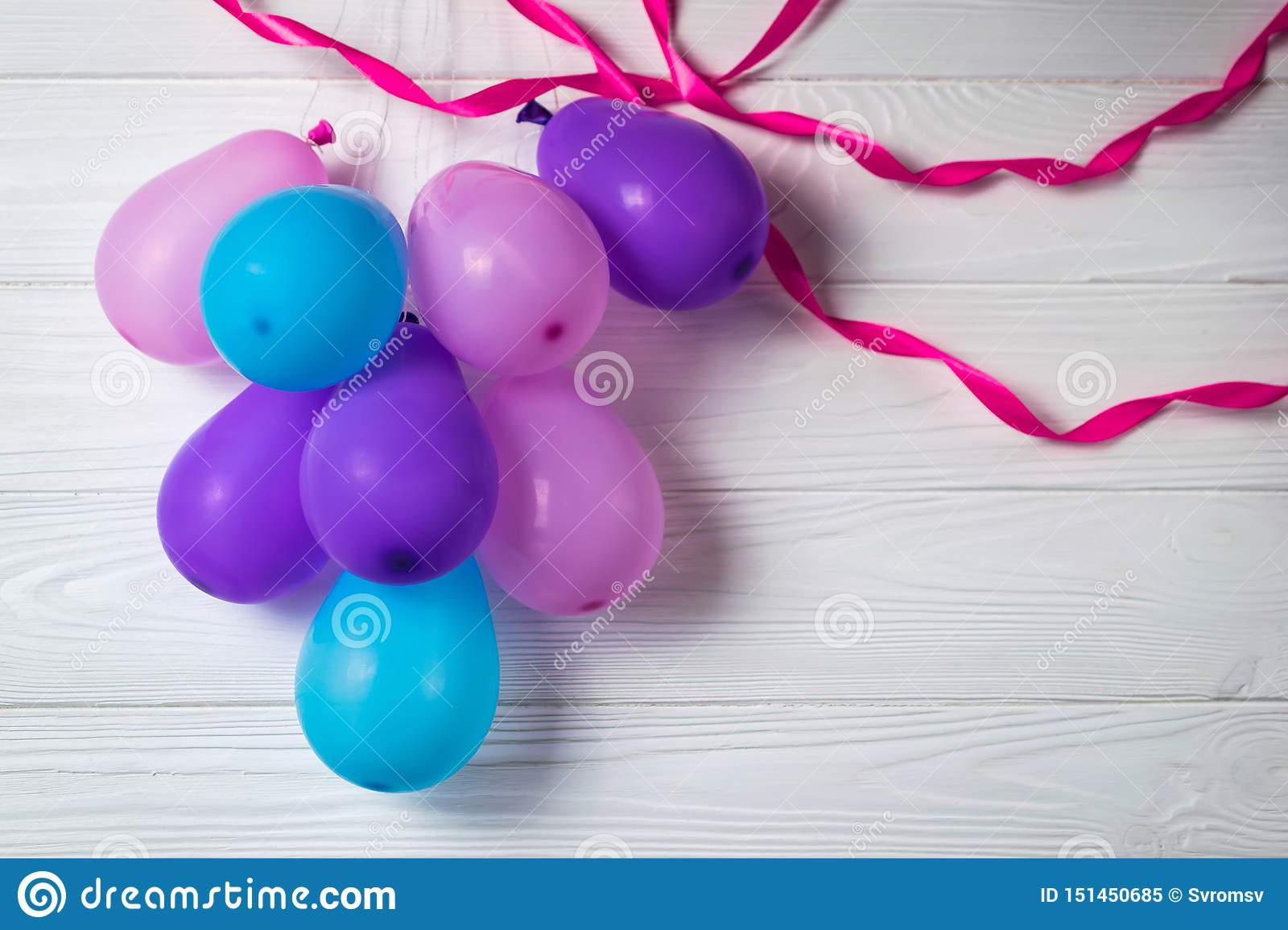 Heap of colorful balloons on white background with ribbons Party birthday card