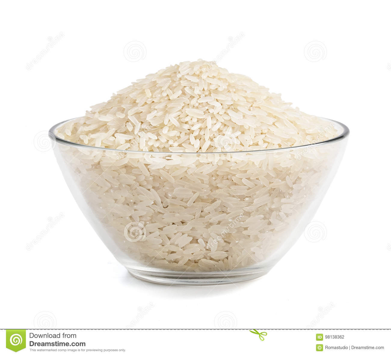 Heap of parboiled rice in glass bowl isolated on white background