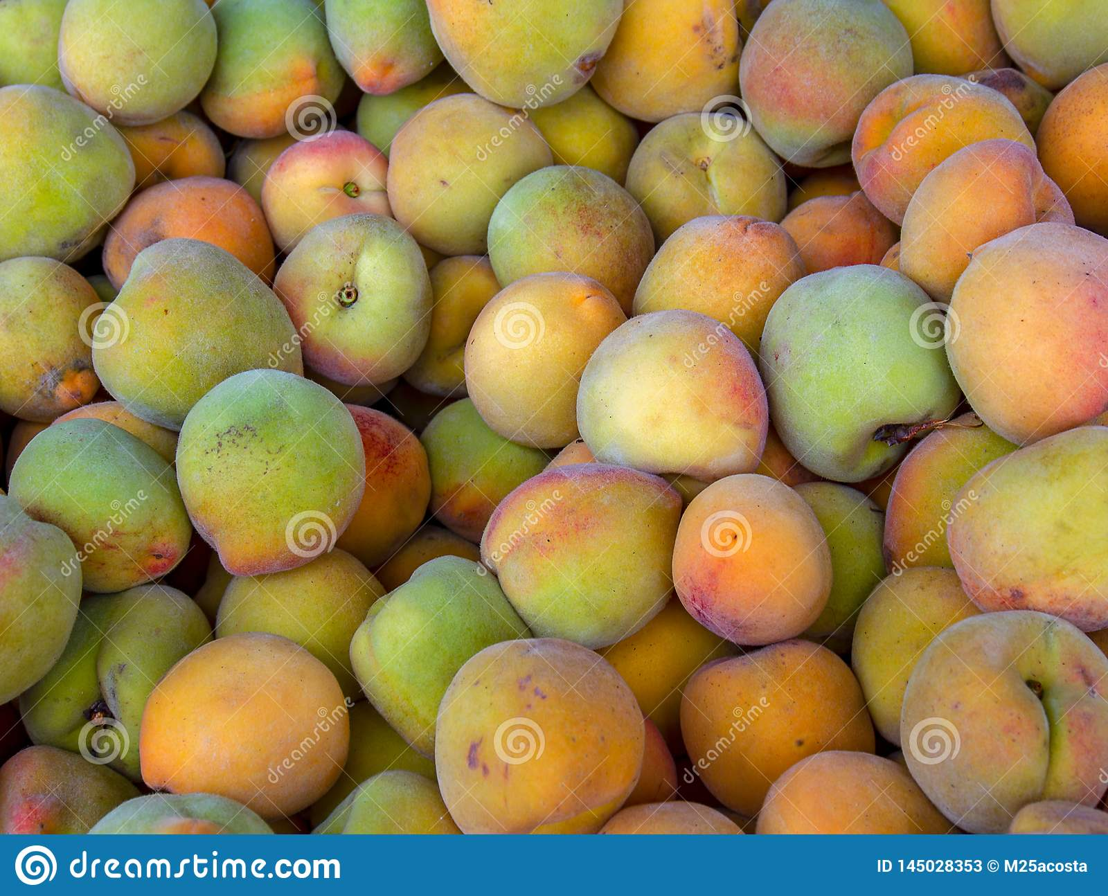 Heap of peaches in a market