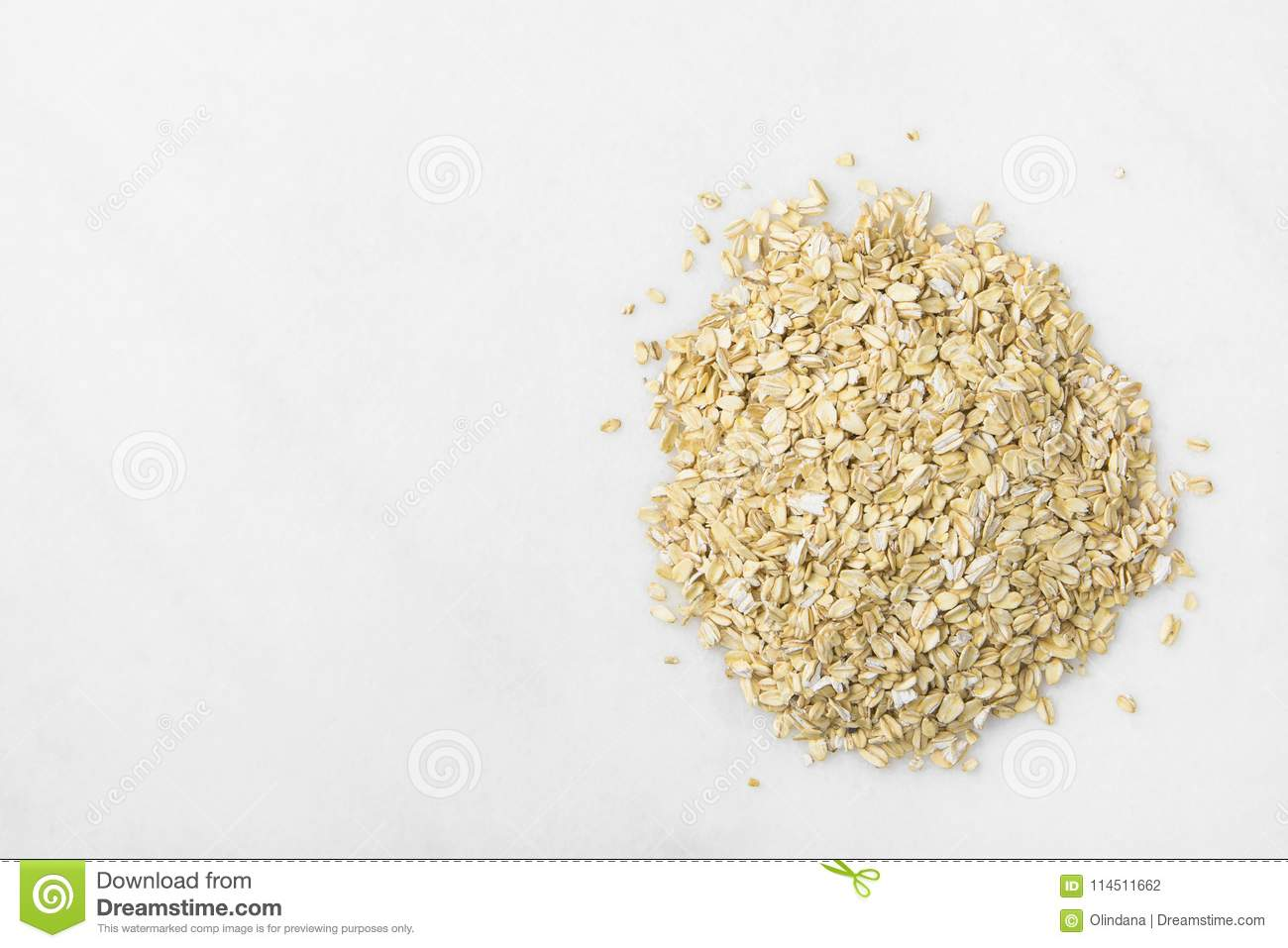 Heap of Rolled Oats Spilled on White Marble Stone Table. Healthy Lifestyle Nutrition Fiber Source Concept