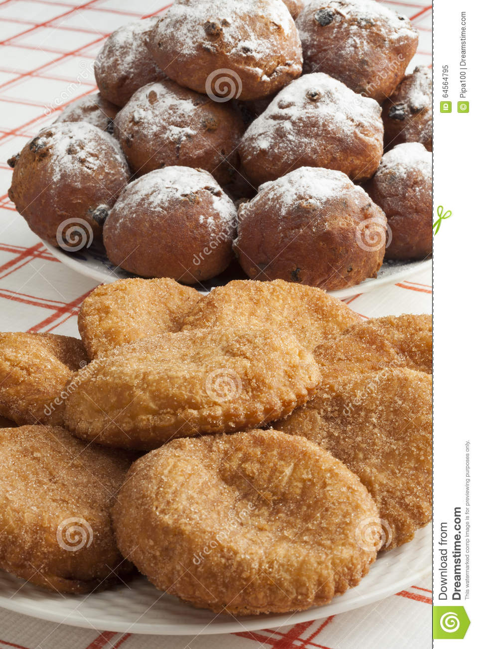 Heap of sugared fried fritters called oliebollen and appelflapp