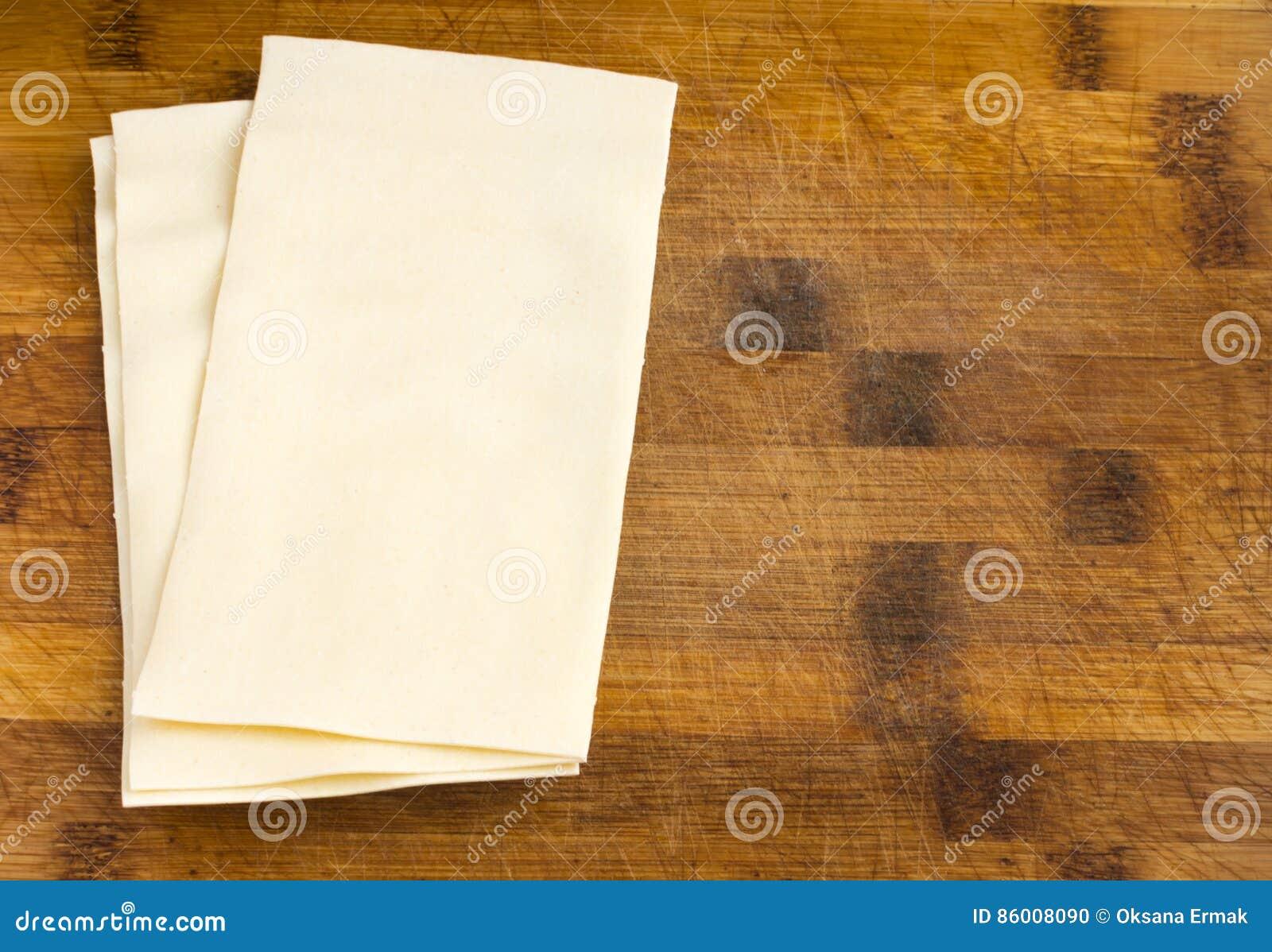 Heap Of Uncooked Lasagna Sheets Or Dry Italian Pasta Stock Photo