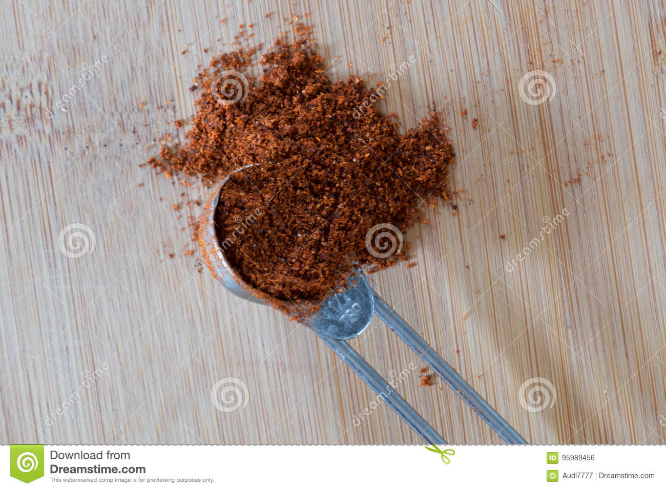 a heaping measuring spoon full of spice stock photo image of