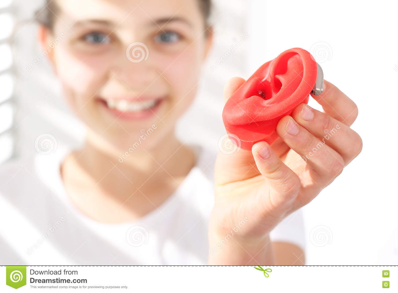The hearing aid for a child.