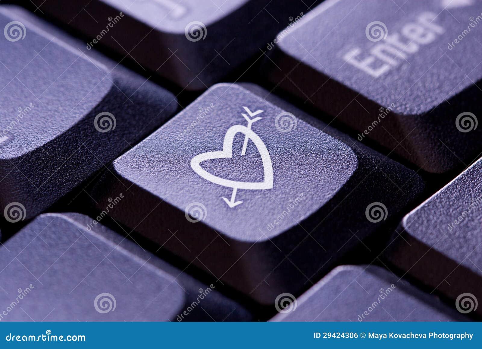 Heart and arrow symbol on computer key stock photo image of online heart and arrow symbol on computer key buycottarizona Choice Image