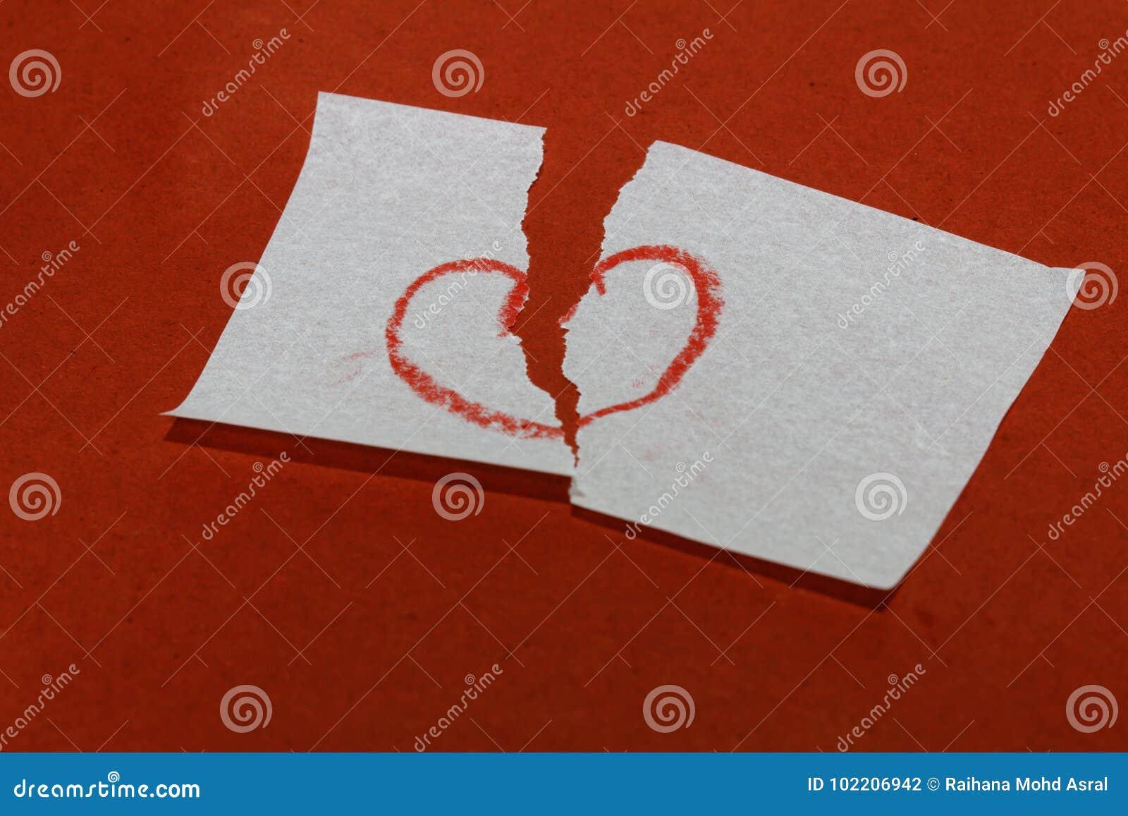 Heart Break Broken Heart Symbol On Red Background Stock Photo