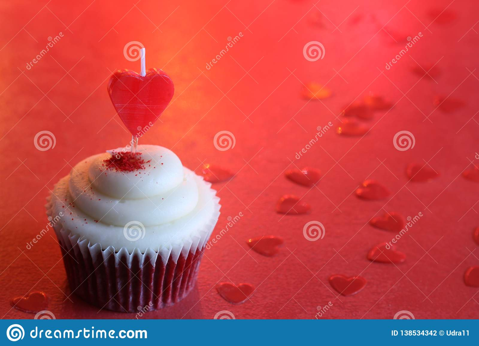 Heart candle in the cupcake on the love abstract defocused valentines day red background