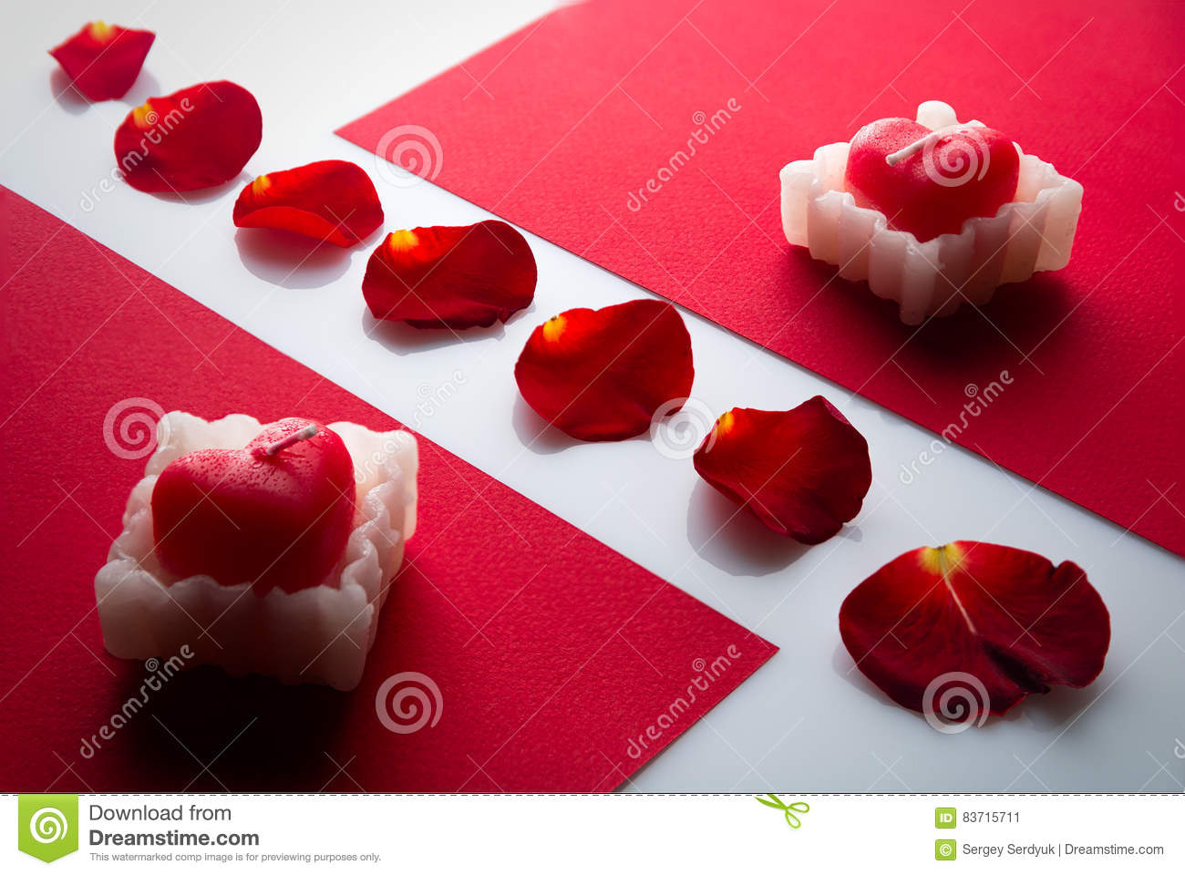 Heart Candle On The Red Cartons, And Rose Petals In Between Stock Photo