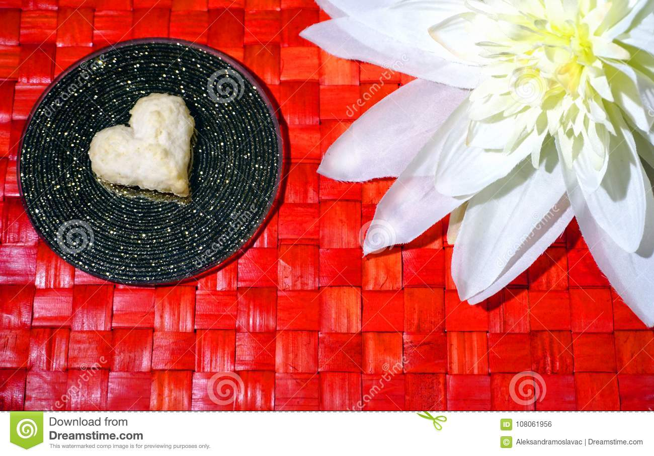 Heart cookie and white flower on red wooden background stock photo download comp mightylinksfo