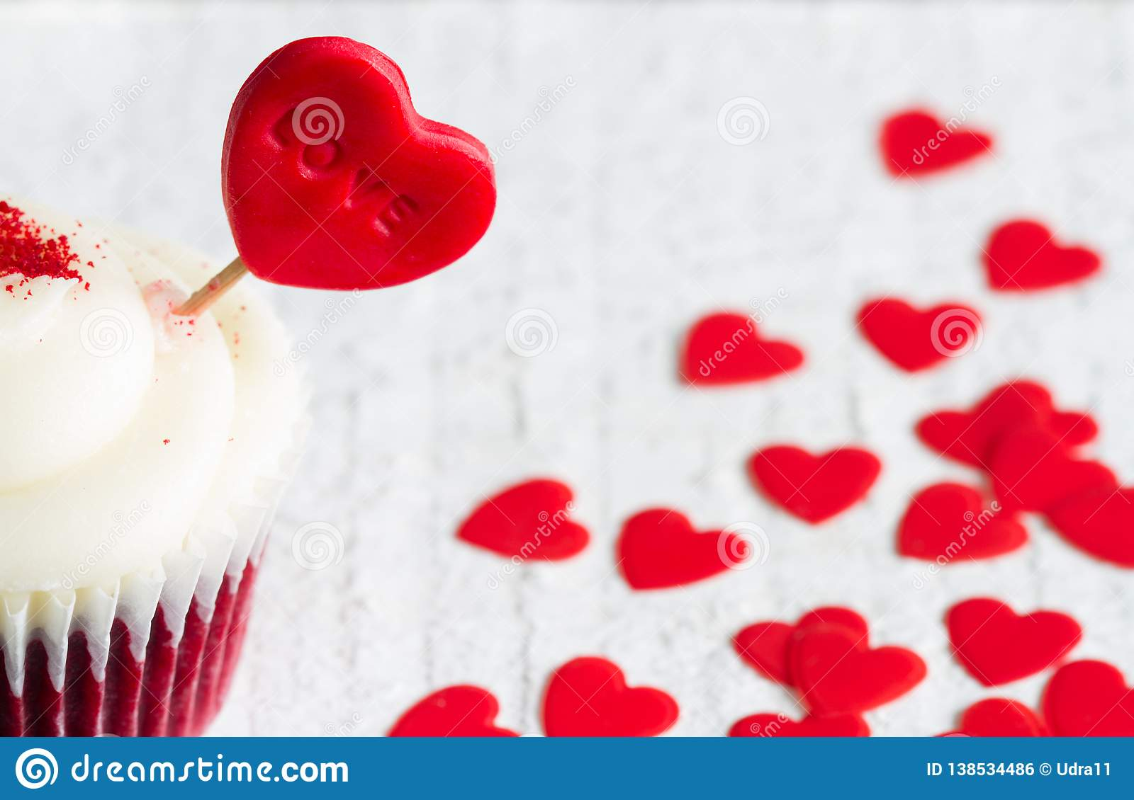 Heart in the cupcake on the love abstract white valentines day red background