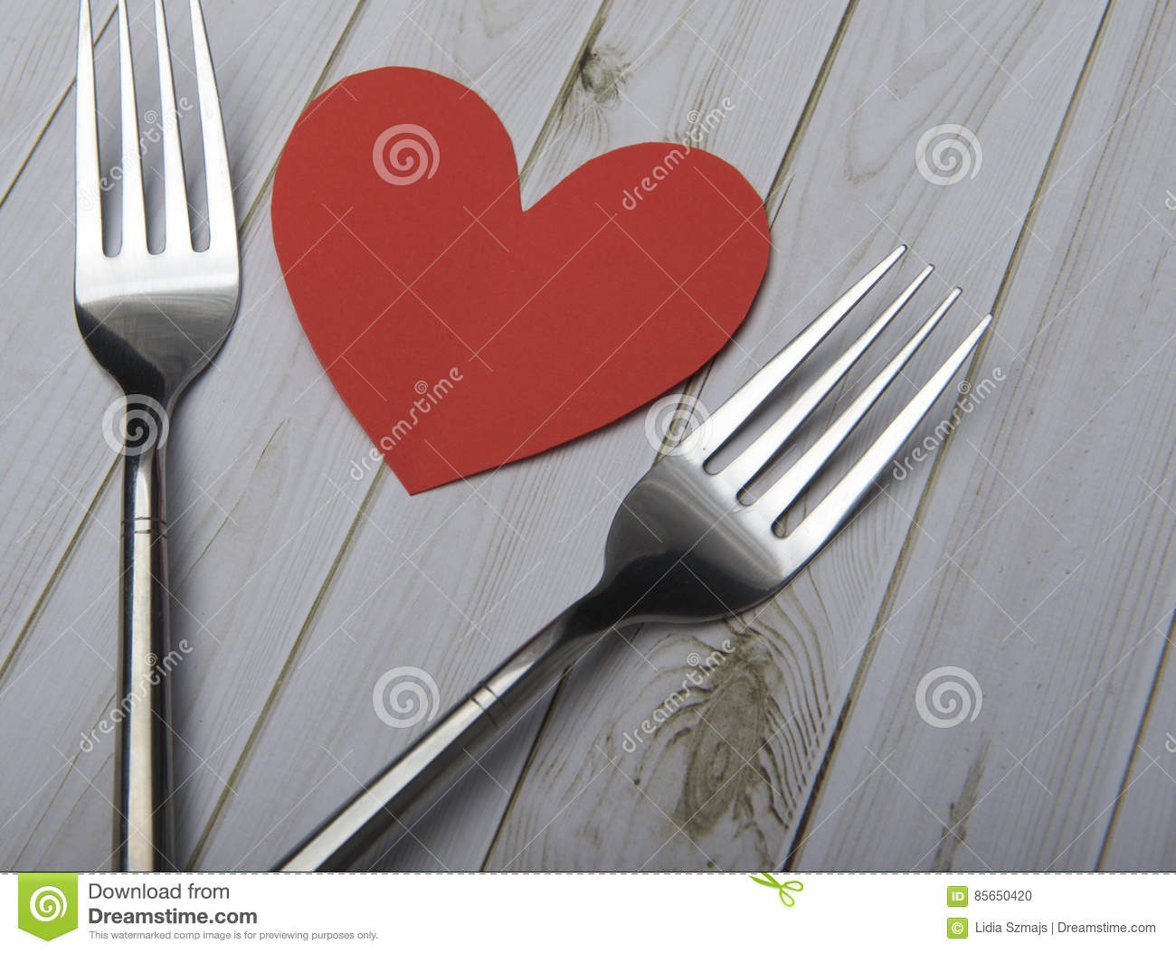 Heart And Cutlery On A Wooden Background Bright Boards Stock Photo