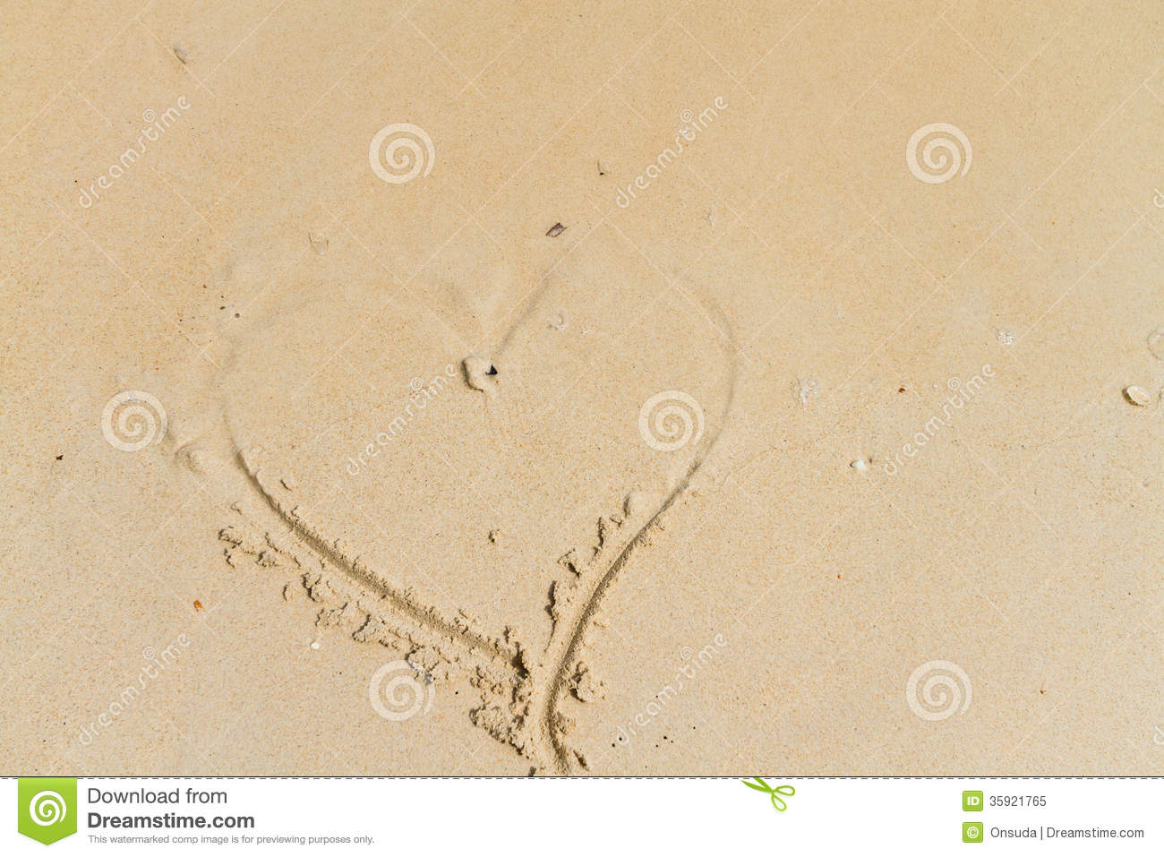 Heart drawing on sand