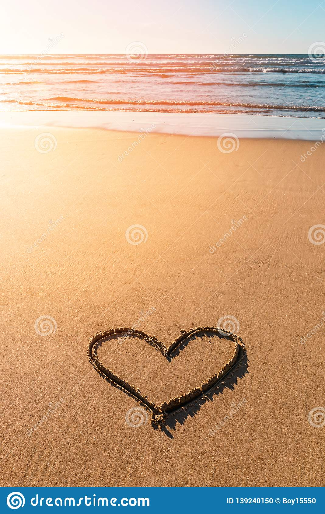 Heart drawn on sand near beautiful beach in valentines day