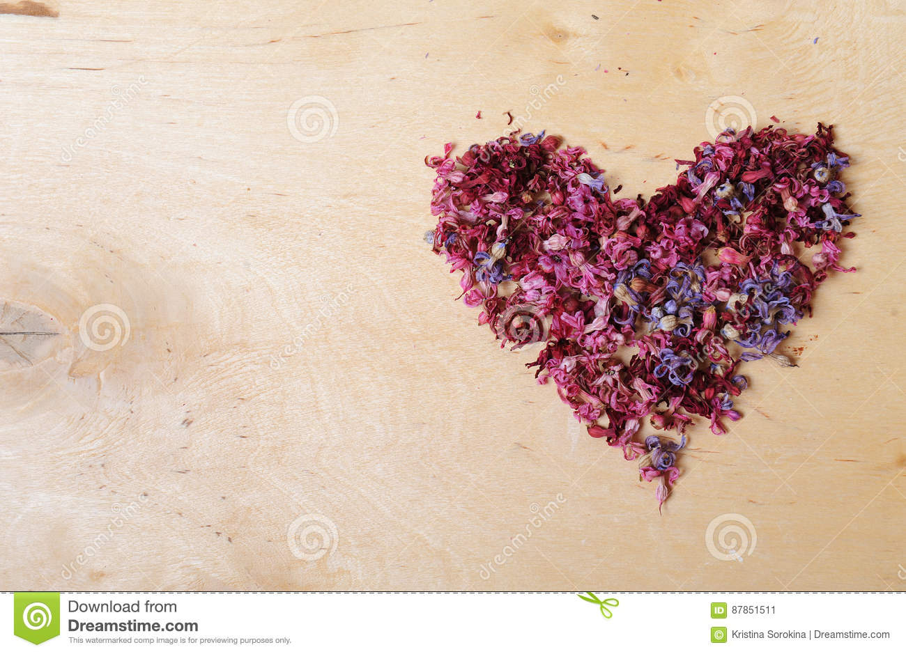 Heart of dried flowers on a wooden background